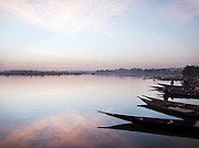 Small fishing boats moored on the banks of the Niger River in Bamako, Mali