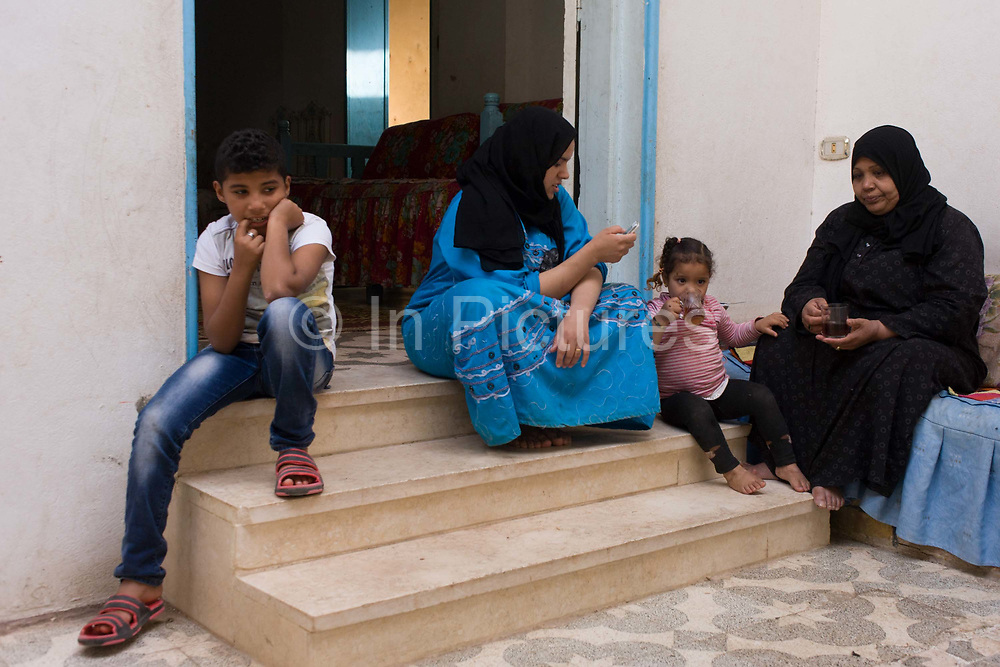 A moderately wealthy Egyptian family of different ages sit on their courtyard steps of their home in the village of Bairat, on the West Bank of Luxor, Nile Valley, Egypt. Egypt is the most populous country in the Middle East and the third-most populous on the African continent (after Nigeria and Ethiopia). About 95% of the country's 82.5 million (2012 est.) people live along the banks of the Nile throughout the Nile Delta, which fans out north of Cairo; and along the Suez Canal. These regions are among the world's most densely populated, containing an average of over 3,820 persons per square mile (1,540 per km².), as compared to 181 persons per sq. mi. for the country as a whole.