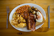 A full English breakfast with brown sauce at Smokey Joe's transport cafe on 05th June 2008 in Blackwater in the United Kingdom. Smokey Joe's is a renowned cafe off the A30 in Blackwater in Cornwall.
