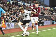 Swansea City defender Joe Rodden (22) battles for possession  with Aston Villa midfielder Callum O'Hare (38) during the The FA Cup 3rd round match between Aston Villa and Swansea City at Villa Park, Birmingham, England on 5 January 2019.