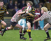 Esher, Surrey. ENGLAND.<br /> <br /> Photo Peter Spurrier<br /> 04/05/2002<br /> Sport - Rugby Union<br /> Tetley's County Championship 1 st Rd<br /> Surrey vs Cornwall<br /> Surrey's defence closes in on stand off James Hawken