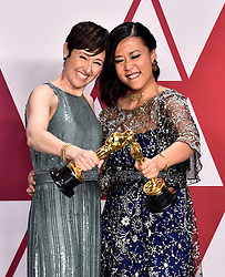 Becky Neiman-Cobb (left) and Domee She with the award for best short film (animated) for Bao in the press room at the 91st Academy Awards held at the Dolby Theatre in Hollywood, Los Angeles, USA.