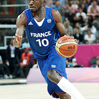 04 August 2012: France Yannick Bokolo goes to the basket during 73-69 Team France victory over Team Tunisia, during the men's basketball preliminary, at the Basketball Arena, in London, Great Britain.