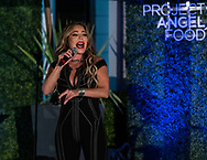 TAYLOR DAYNE at Project Angel Food's 'Evening Under the Stars' with Josh Flagg and Bobby Boyd at the private home of 'Million Dollar Listing' star Josh Flagg in Beverly Hills, California