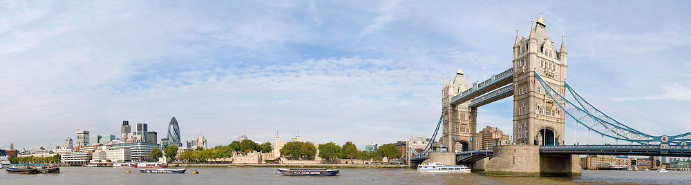 London's Tower Bridge and city skyline with Thames River