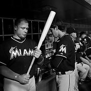 Justin Bour, MIami Marlins, in the dugout preparing to bat during the New York Mets Vs Miami Marlins MLB regular season baseball game at Citi Field, Queens, New York. USA. 16th September 2015. Photo Tim Clayton