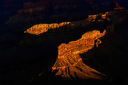 First Golden Light Illuminating a Grand Canyon Mesa.  Fine art print for sale or licensed use