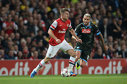 LONDON, ENGLAND - Oct 01: Arsenal's midfielder Aaron Ramsey from Wales and Napoli's midfielder Valon Behrami from Switzerland during the UEFA Champions League match between Arsenal from England and Napoli from Italy played at The Emirates Stadium, on October 01, 2013 in London, England. (Photo by Mitchell Gunn/ESPA)