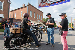 Kevin Waters on his 1931 Sunbeam M9 Antique stops for Check-in at the finish before the Hosted Dinner stop on Spanish Street in Cape Girardeau, Missouri during Stage 5 of the Motorcycle Cannonball Cross-Country Endurance Run, which on this day ran from Clarksville, TN to Cape Girardeau, MO., USA. Tuesday, September 9, 2014.  Photography ©2014 Michael Lichter.