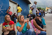 2016/05/26 - Caracas, Venezuela: Thaminia Moreno, 39 and Deysy Alvaréz, 43, wait for the chance of some basic products arrive to Plan suarez supermerket in La Urbina neighbourhood, Caracas. Even if there aren't subsidized products available on the supermarkets, people start queuing for hours in order to be in the front line if any product is made available. (Eduardo Leal)