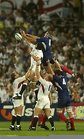 Photo: Richard Lane.<br />France v England. Semi-Final, at the Telstra Stadium, Sydney. RWC 2003. 16/11/2003. <br />Ben Kay and Imanol Harinordoquy challenge for the ball.