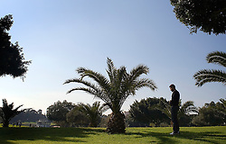 Israeli football star Abbas Suan, prays in a park during an outing with his family, Ramat Gan, Isreal, Jan. 31, 2006. Suan, an Israeli-Arab, still faces criticism and racism resulting from the unsettled conflict between the Israelis and Palestinians.