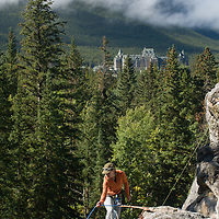 Barb Wilson climbs at Rundle Rock near the Banff Springs Hotel in Banff, Alberta, in Canada's Banff National Park.