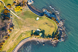 Aerial view from drone of first green at Aberdour Golf Course,  Fife , Scotland, UK
