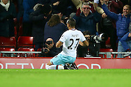 Dimitri Payet of West Ham United celebrates after scoring his teams 1st goal. Premier League match, Liverpool v West Ham Utd at the Anfield stadium in Liverpool, Merseyside on Sunday 11th December 2016.<br /> pic by Chris Stading, Andrew Orchard sports photography.
