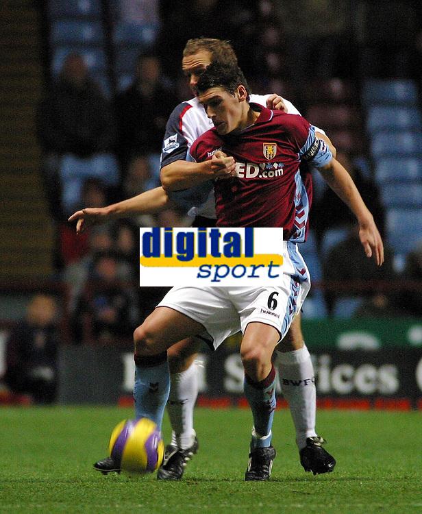 Photo: Dave Linney.<br />Aston Villa v Bolton Wanderers. The Barclays Premiership. 16/12/2006 Villa's .Gareth Barry (R)keeps  Kevin Davies<br />at bay.