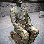 Stylized sculpture of a younger FDR in a wheelchair at the Franklin D. Roosevelt Memorial in Washington DC on Haines Point on the banks of the Tidal Basin