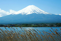 Mount Fuji or Fuji-san as it is called in Japan (not Fujiyama)  is the highest mountain in Japan at 3,776 meters or 12,388 feet in altitude.  Mt Fuji is an active volcano that last erupted in 1707; Fuji straddles Shizuoka and Yamanashi prefectures just west of Tokyo, from where it can be seen on a clear day. Mount Fuji's symmetrical cone is a well known symbol of Japan and is frequently visible in art and photographs.  Although Mount Fuji has not erupted in over 300 years its still not considered to be extinct.