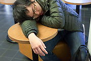 boy sleeping in a public space Japan