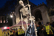 April, 18th, 2019 - London, Greater London, United Kingdom: Police evacuation of occupation with skeletons. Westminster Parliament Square Demonstration against Climate Crisis. Extinction Rebellion is demanding the UK government takes urgent action on climate change and wildlife declines. Extinction Rebellion activists disrupt traffic around famous London Landmarks. Thousands of protesters  converging on central hubs including Oxford Circus and Parliament Square. Nigel Dickinson/Polaris