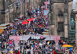Edinburgh, Scotland, UK; 5 August, 2018. Edinburgh Fringe Festival's first weekend sees thousands of tourists and locals on the Royal Mile  enjoying the free street performers. Pictured; View of crowds on the Royal Mile .