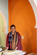 Qamar Dagar, a celebrated calligrapher that works in both Hindi and Urdu script to produce art that is collected internationally at her studio in New Delhi, India
