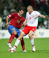 Fotball<br /> EM-kvalifisering<br /> 06.09.2006<br /> Polen v Serbia<br /> Foto: Wrofoto/Digitalsport<br /> NORWAY ONLY<br /> <br /> MARIUSZ LEWANDOWSKI /R/ OF POLAND AND DEJAN STANKOVIC /L/ OF SERBIA