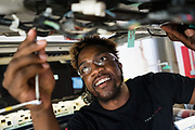 Rakee Cromwell of Philadelphia works on a Tesla Model X door during the Tesla Start class at Evergreen Valley Community College in San Jose, California, on August 8, 2019. (Stan Olszewski for Silicon Valley Business Journal)
