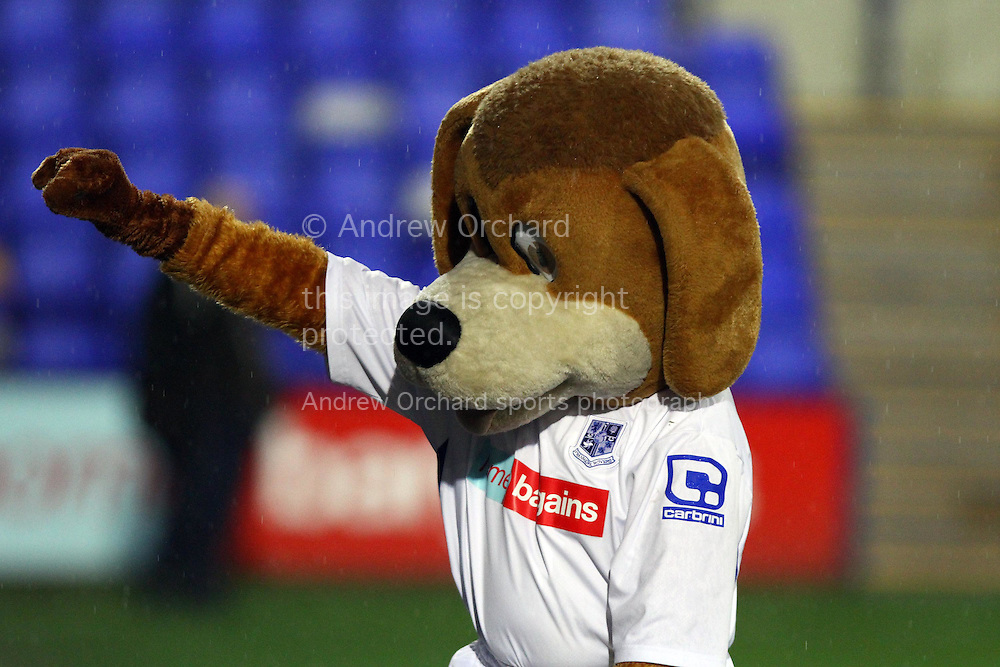 Tranmere Rovers Mascot Rover salutes the crowd. The FA Cup, 2nd round replay, Tranmere Rovers v Oxford United at Prenton Park in Birkenhead, England on Tuesday 16th December 2014.<br /> pic by Chris Stading, Andrew Orchard sports photography.