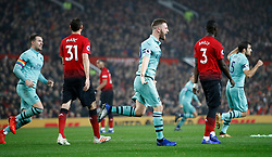 Arsenal's Shkodran Mustafi celebrates scoring his side's first goal of the game during the Premier League match at Old Trafford, Manchester.
