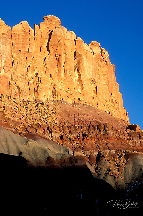 Evening light on the sandstone cliffs and sedimentary layers of the Waterpocket Fold, Capitol Reef National Park, Utah