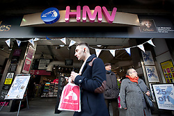 © Licensed to London News Pictures. 15/01/2013. London, UK. Shoppers are seen outside HMV in Oxford Street, London, today (15/01/13) after the retailer went in to administration. Photo credit: Matt Cetti-Roberts/LNP