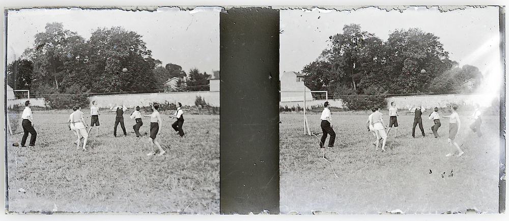stereo image with young people playing a game of basketball