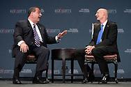 New Jersey Gov. Chris Christie, left, answers questions from Florida Gov. Rick Scott during Rick Scott's Economic Growth Summit in Lake Buena Vista, Fla., Tuesday, June 2, 2015. (AP Photo/Phelan M. Ebenhack)
