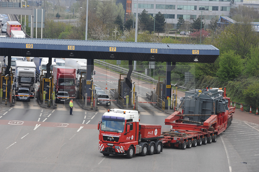 © Licensed to London News Pictures. 27/04/2013.Dartford tolls closed to hold traffic while an abnormal wide vehicle travels to London carrying a power station turbine.. The turbine is so heavy it had to cross the Queen Elizabeth II Bridge at Dartford on its own..Power station Turbine abnormal wide load travelling on the M25 and A3 From Tilbury in Essex to New Cross in London this weekend causing traffic congestion.. The vehicle will be straddling two lanes and restricted to 10mph speed limits when passing junctions and crossing bridges, including the Queen Elizabeth II Bridge at Dartford. Police will escort the vehicle throughout its journey.. Its journey will start at approximately 8am (27.04.2013), when the vehicle leaves the Tilbury Docks. A rolling road block will be implemented to allow it to cross the Queen Elizabeth II Bridge. This is expected to be between 9.30am and 10am. The vehicle is expected to reach Clacket Lane Services by 1pm..On (28.04.2013), the vehicle will move out of Clacket Lane Services at 8am, with an approximate arrival time in New Cross before 10am..Photo credit :Grant Falvey/LNP
