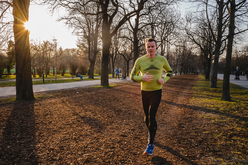 Man jogging in the park at sunset, Prater Park, Vienna, Austria