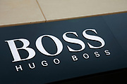Sign for the high street clothing brand Hugo Boss in Birmingham, United Kingdom.