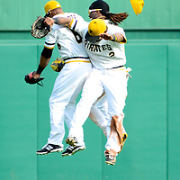 Pittsburgh Pirates center fielder Andrew McCutchen (22)  cap flies off his head as left fielder Jose Tabata (31)and Pirates right fielder Marlon Byrd (2) celebrates the 3-2 win against the Chicago Cubs at PNC Park in Pittsburgh, on September 15, 2013.  UPI/Archie Carpenter