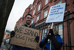© Licensed to London News Pictures . 12/01/2016 . Manchester , UK . Junior doctors walk out to a picket outside the Manchester Royal Infirmary in England as the first of three planned strikes over pay and working conditions starts this morning (12th January 2016) at 8am . Photo credit : Joel Goodman/LNP