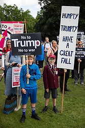 © Licensed to London News Pictures. 03/06/2019. London, UK. Anti-Trump demonstrators protest outside Buckingham Palace as the President of the United States of America Donald Trump (not pictured) joins the Queen for a State Banquet at Buckingham Palace. Photo credit : Tom Nicholson/LNP