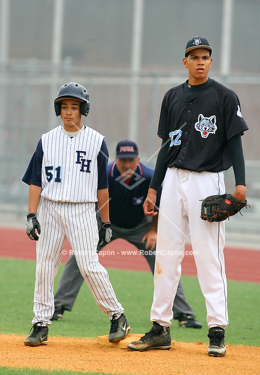 """Dellin Betances, right, is a 6-9, 215 pound righthanded pitcher at Brooklyn's Grand Street Campus High School who will likely become a first-round pick in the MLB amateur draft this spring, and could become the highest pick from New York City since Manny Ramirez. Already nicknamed the """"Baby Unit"""" (he grew six inches over his first three years of high school), Betances was dominating at last summer's AFLAC All-American High School Baseball Classic last summer. Robert Caplin For The New York Times"""