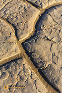 Dried mud cracks of ancient lakebed in The Mesquite sand dunes in Death Valley National Park, California, USA