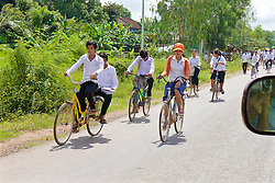 Students Getting Out Of School Riding Bicycles
