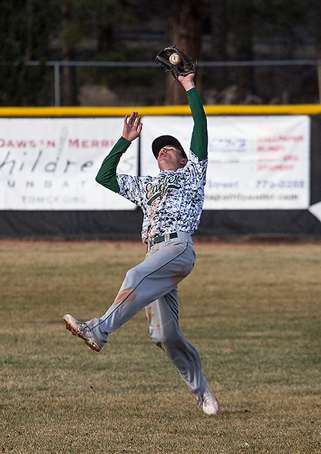 Flagstaff's second baseman, Avery Wilson, hustles back to shallow right field to catch a blooper Popfly during the Flagstaff vs. Coconino baseball game on Monday. Even with some outstanding defense by Flagstaff, Coconino battles would make the difference in the game as Coconino wins 5-2. (Photo by David Carballido-Jeans)