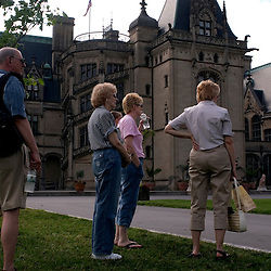 ASHEVILLE, NC-- Tourists line up outside the Biltmore House, waiting for the shuttle bus to the parking lot.  Built and owned by the Vanderbilt family for over 100 years, it is one of Asheville's most popular tourist attractions.