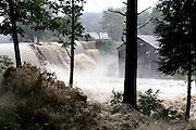 Kennedy's Pond pours over the damaged Ascutney Mill Dam in Windsor, Vt. Sunday, August 28, 2011. <br /> Valley News - James M. Patterson<br /> jpatterson@vnews.com<br /> photo@vnews.com