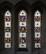 Stained glass in north transept window depicting biblical scenes by Clayton and Bell, undated, in church of Saint Mary, Potterne, Wiltshire, England