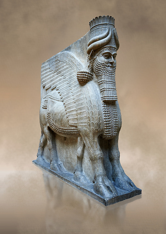 Stone statue of a winged bull. From city gate no 3,  Inv AO 19859 from Dur Sharrukin the palace of Assyrian king Sargon II at Khorsabad, 713-706 BC.  Louvre Museum Room 4 , Paris .<br /> <br /> If you prefer to buy from our ALAMY PHOTO LIBRARY  Collection visit : https://www.alamy.com/portfolio/paul-williams-funkystock/ancient-assyria-antiquities.html  Refine search by adding background colour, place, subject, museum etc into the LOWER SEARCH WITHIN GALLERY box to <br /> <br /> Visit our ANCIENT WORLD PHOTO COLLECTIONS for more photos to download or buy as wall art prints https://funkystock.photoshelter.com/gallery-collection/Ancient-World-Art-Antiquities-Historic-Sites-Pictures-Images-of/C00006u26yqSkDOM