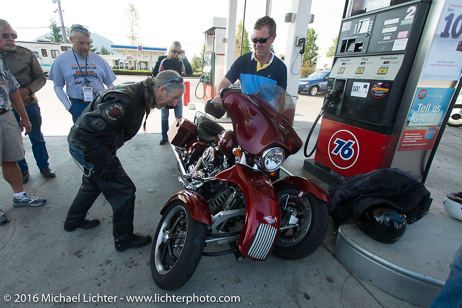 Pat Simmons of the Doobie Brothers checks out a unique Harley-Davidson 3-Wheeler during Stage 16 (142 miles) of the Motorcycle Cannonball Cross-Country Endurance Run, which on this day ran from Yakima to Tacoma, WA, USA. Sunday, September 21, 2014.  Photography ©2014 Michael Lichter.