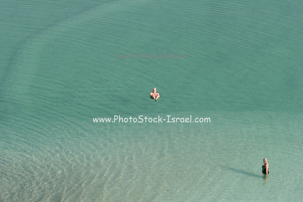 Israel, Dead Sea tourists float in the water